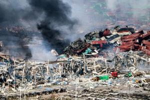 14 August, 2015: Crawford adjusters work among devastation in Tianjin, China, following two warehouse explosions that left widespread damage. ©NAITONG LIU/NEWZULU/Alamy Live News
