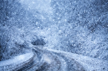 Winter weather can lead to treacherous driving conditions. Photo credit: Peter Zelei via istockphoto.com.