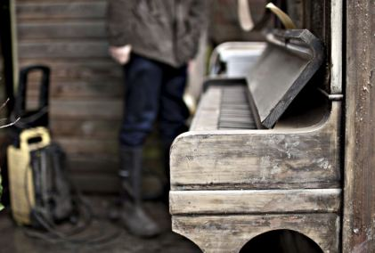 This flood-damaged piano needs more than a retune. Photo credit: DJM Photography