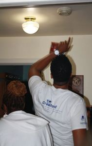 Crawford volunteers in Atlanta install smoke alarms as part of the company's Global Day of Service in October 2015.