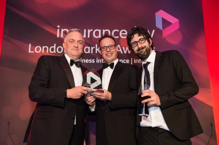 Crawford's Clive Nicholls, left, accepts the Adviser of the Year award on behalf of Crawford & Company during the recent Insurance Day London Market Awards 2016 ceremony.